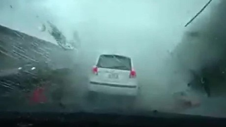 Watch a typhoon blow this car away