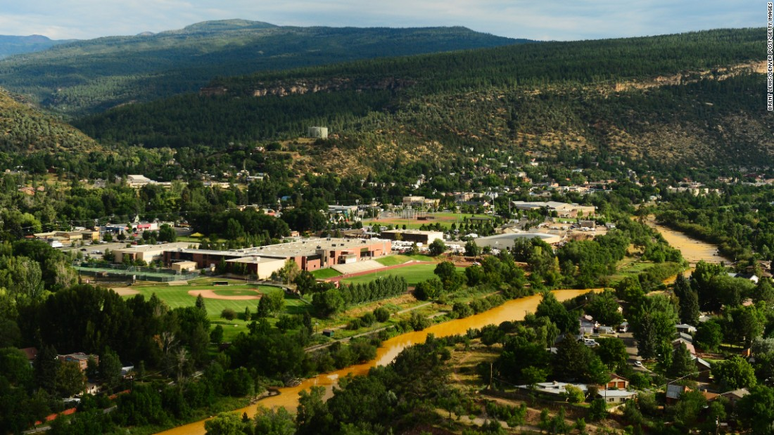 The contaminated Animas River flows through Durango on August 7. Over 2 million gallons of mine wastewater made its way into the river, putting the city on alert.