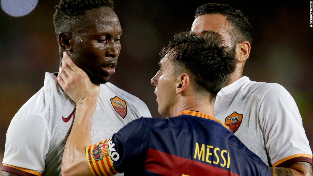 Lionel Messi of FC Barcelona grabs AS Roma defender Mapou Yanga-Mbiwa by the throat during the Joan Gamper Trophy match on Wednesday, August 5, in Barcelona.