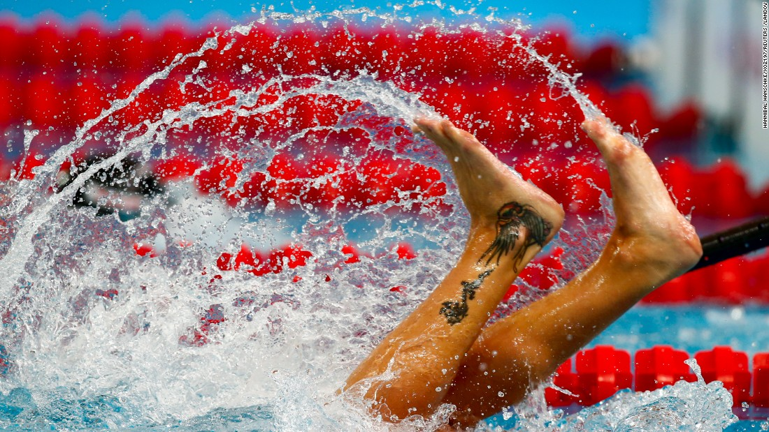 Italy's Federica Pellegrini makes a turn as she competes in the women's 200 meter freestyle preliminaries at the Aquatics World Championships in Kazan, Russia, on Tuesday, August 4.