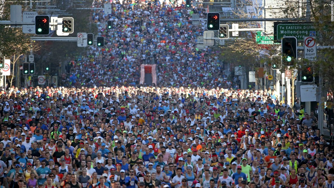 Competitors race along William Street during the start of the City2Surf fun run in Sydney on Sunday, August 9.