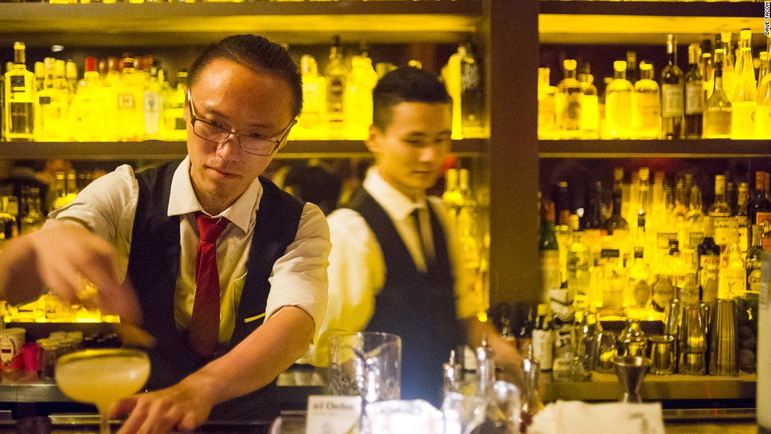 Hiker Yao, (left) bartender at El Ocho, prepares a Corpse of Old Tom, one of the venue's signature cocktails.