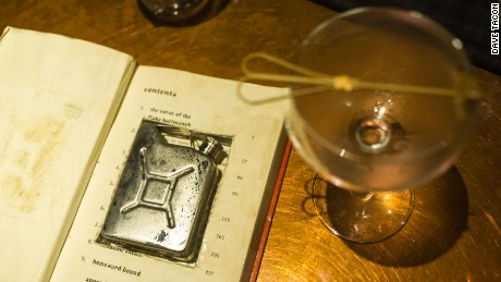 """Robin Hood Roy,"" a signature cocktail at Flask, comes in a petrol-can-shaped flask hidden inside a book."