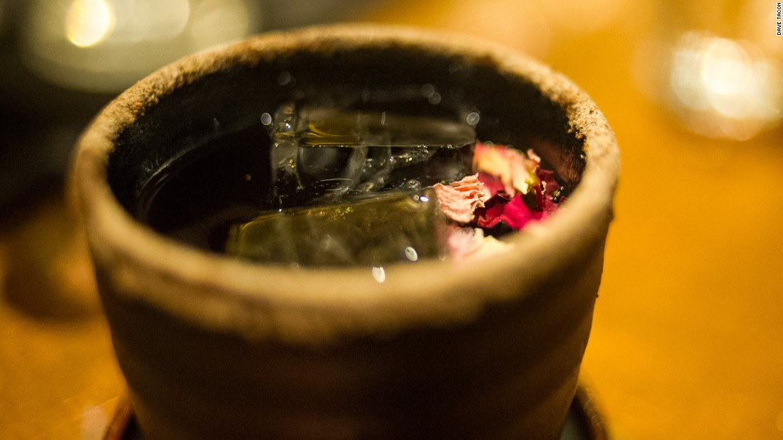 Taiwan Plum Soup features Zacapa rum, an infusion of longan juice, sherry and creme de cassis, Prucia plum liqueur, sweet osmanthus wine, dried chrysanthemum flowers and a dusting of salty plum sugar on the rim of an earthenware cup.