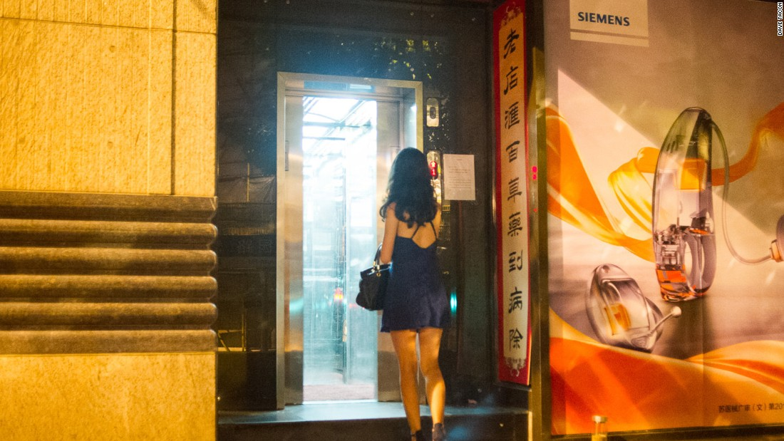 The street level entrance to Tailor cocktail bar is a nondescript elevator next to a Chinese medicine store.