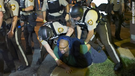 A demonstrator is arrested on August 10, 2015 during a protest marking the one-year anniversary of the shooting of Michael Brown in Ferguson, Missouri. Michael Brown was shot and killed on August 9, 2014.