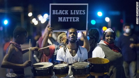 Demonstrators protest in Ferguson, Missouri on August 10, marking the one-year anniversary of the shooting of Michael Brown.