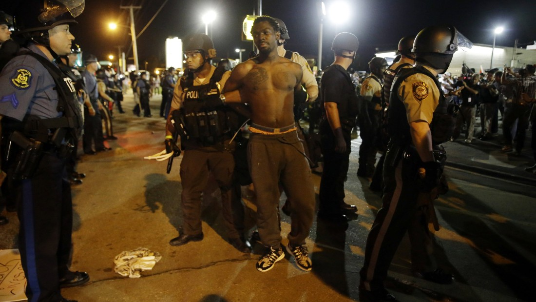 St. Louis County Police make an arrest on Monday, August 10, in Ferguson, Missouri, marking the one year anniversary of the death of Michael Brown.