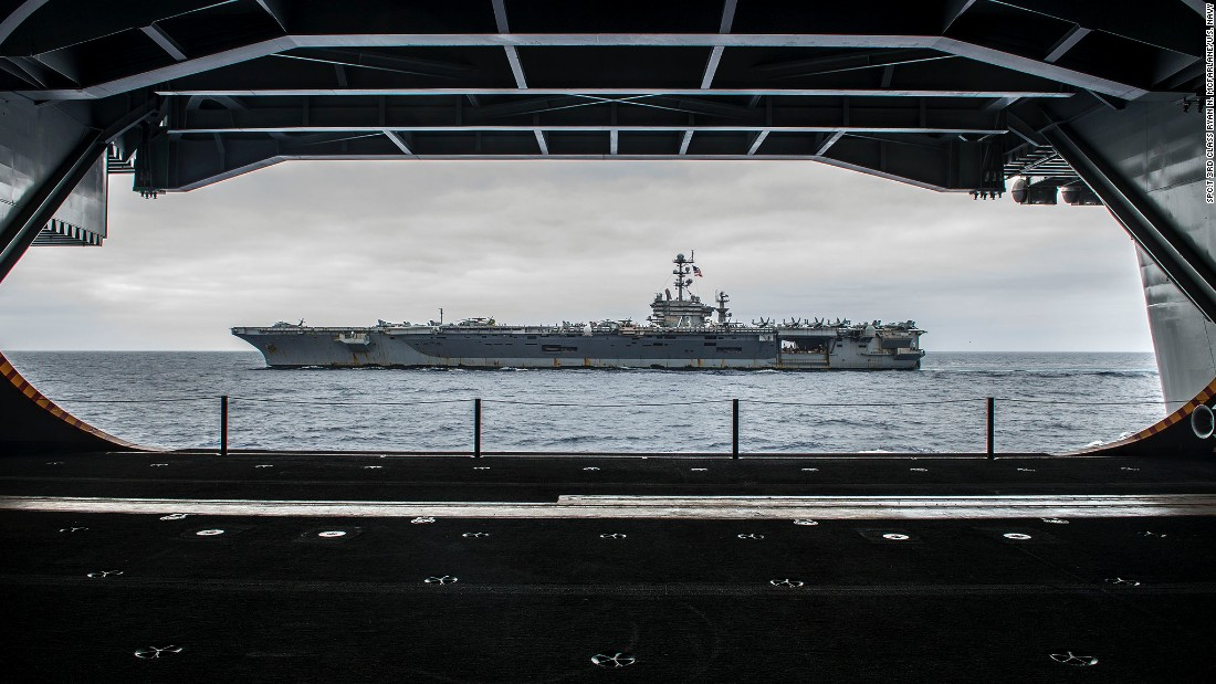 "The Nimitz-class aircraft carrier USS George Washington (CVN 73) is seen from inside its sister ship, the USS Ronald Reagan (CVN 76), on August 7 off the coast of California as the two ships prepare for<a href=""http://www.cnn.com/2015/03/04/us/us-navy-three-presidents/""> a ""hull swap.""</a>  Over 10 days in San Diego, much of the crew of each ship will transfer to the other. When completed, the Reagan will head to forward deployment in Japan, where the Washington had been. The Washington will head to Newport News, Virginia, for an overhaul."