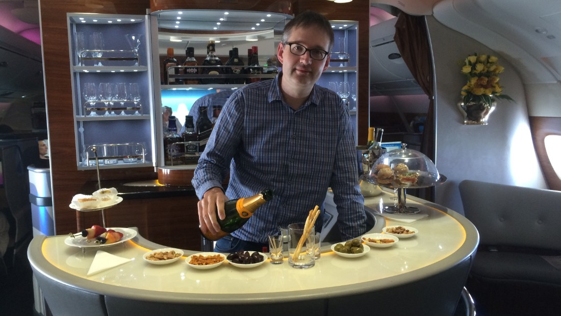 """Rob Burgess edits <a href=""""http://www.headforpoints.com/"""" target=""""_blank"""">Head for Points</a>, which helps fliers """"maximize their miles."""" Here he takes a break at the business class bar on an Emirates A380 flight."""