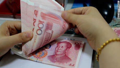 A teller counts yuan banknotes in a bank in Lianyungang, east China's Jiangsu province on August 11, 2015. China's central bank on August 11 devalued its yuan currency by nearly two percent against the US dollar, as authorities seek to push market reforms and bolster the world's second-largest economy. CHINA OUT AFP PHOTOSTR/AFP/Getty Images