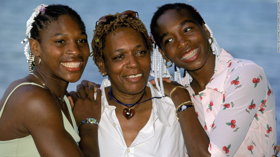 The Williams sisters pose for a photo with their mother, Oracene Price, in March 1999.