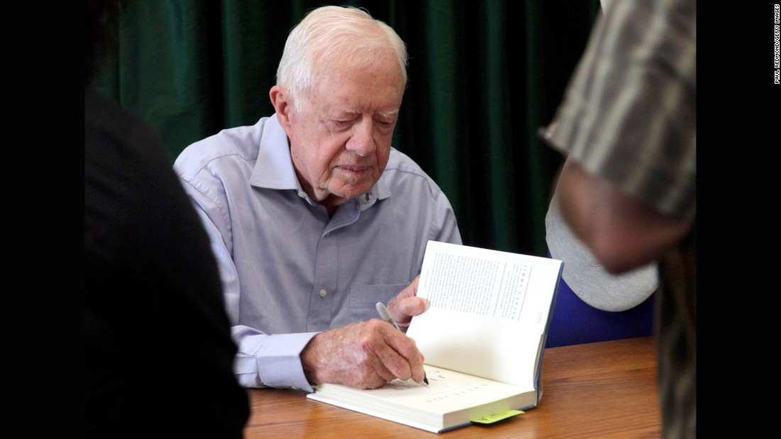 "Carter signs his book ""A Full Life: Reflections At Ninety"" in Pasadena, California, in July 2015."