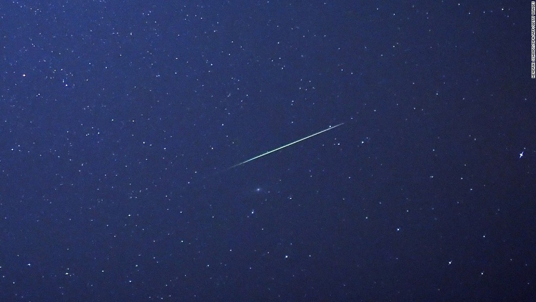 A meteor streaks across the sky above Halle, Germany, early Thursday, August 13. The Perseid meteor shower occurs every August when the Earth passes through the debris and dust of the Comet Swift-Tuttle.