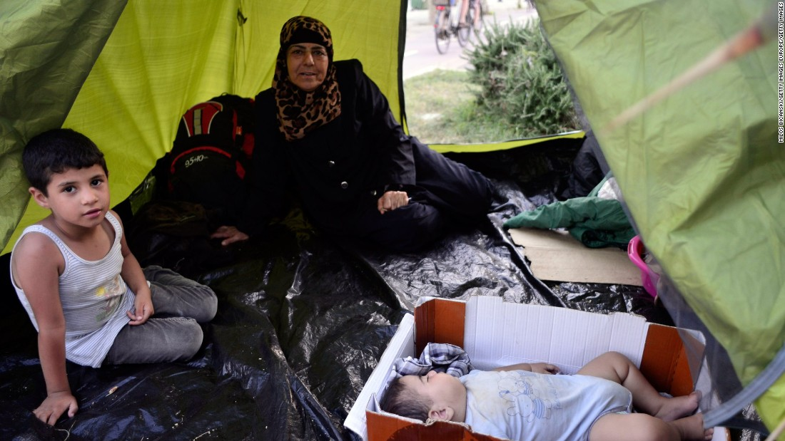 A Syrian family takes shelter at a makeshift camp in the center of town on August 12.