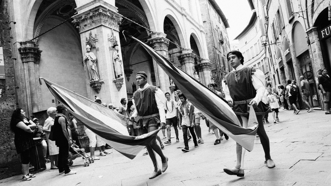 """The Palio is a hugely colorful event but I've always enjoyed shooting in black and white -- for me the Palio feels quite timeless, and the absence of color helped maintain that feeling,"" says Funnell, who attended the event in 2014.<br /><br />""The race itself takes places after hours of parades and build up ... the importance of the race to the cultural identity of the Sienese cannot be taken lightly and is something very difficult for an outsider to fully grasp."""
