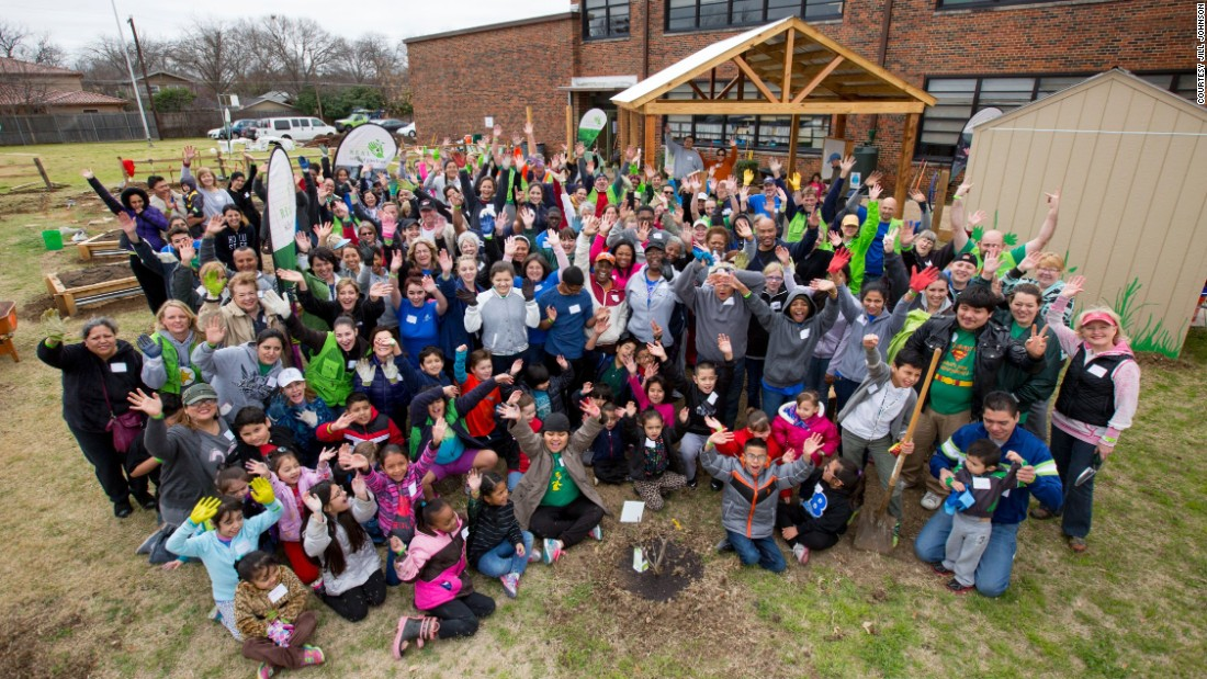 "Students, parents and teachers at Sudie L. Williams Elementary School in Dallas, Texas, before the ""Big Dig"" with REAL School Gardens to build their school garden. They are joined by Blue Cross and Blue Shield of Texas employees."