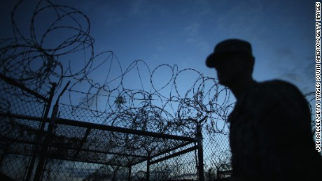 A Public Affairs Officer escorts media through the currently closed Camp X-Ray which was the first detention facility to hold 'enemy combatants' at the U.S. Naval Station on June 27, 2013 in Guantanamo Bay, Cuba.