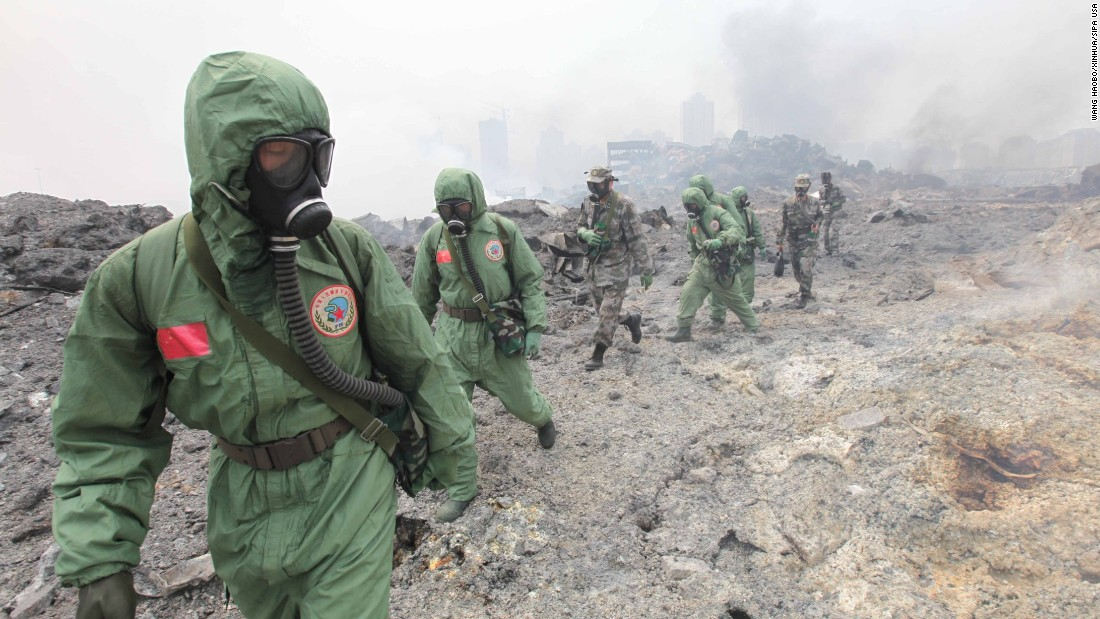 Soldiers from the National Nuclear Biochemical Emergency Rescue Team launch a rescue mission August 15 at the core area of the explosion site.