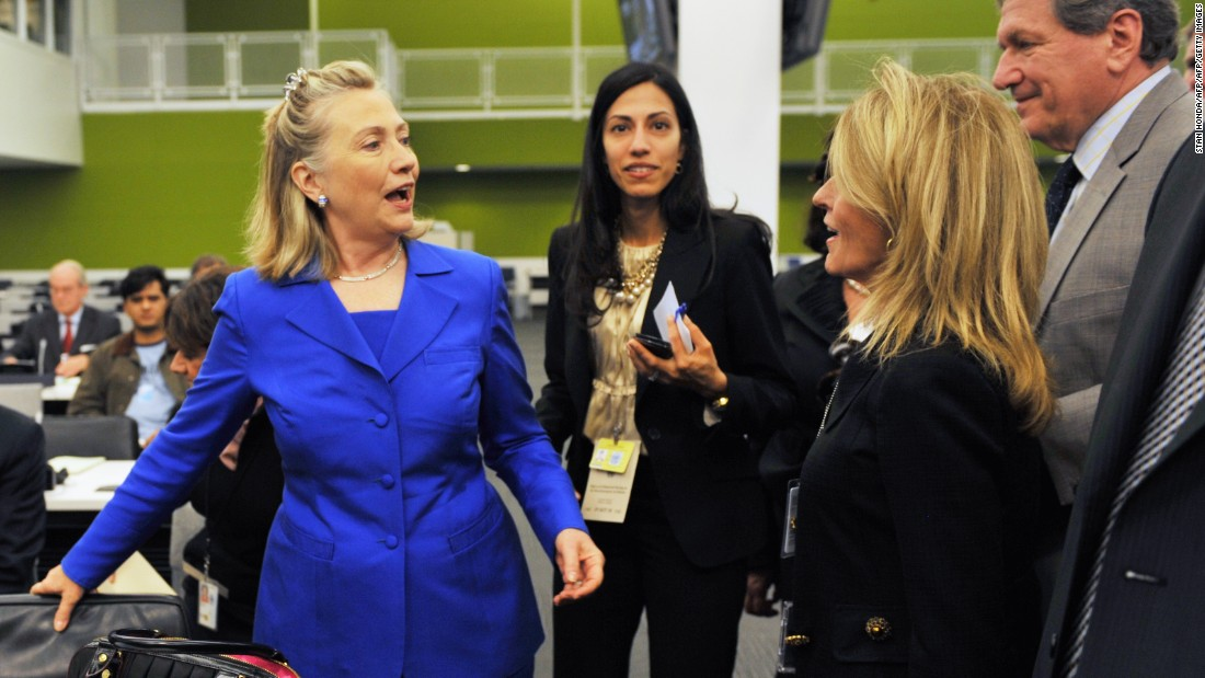 Clinton (left), accompanied by Abedin (center), greets people before a meeting on the Flood Emergency in Pakistan September 19, 2010 at United Nations headquarters in New York.