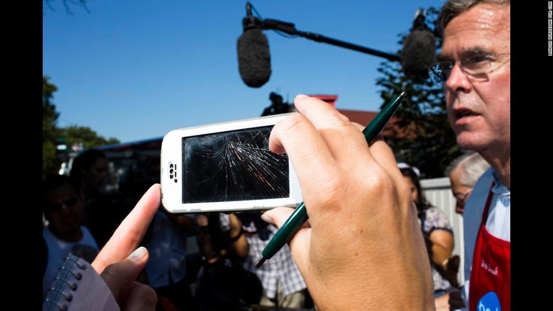"A reporter uses a cracked smart phone to record Bush. The Republican presidential candidate has become widely known for his <a href=""http://www.cnn.com/2015/08/14/politics/jeb-bush-paleo-diet-iowa/"">weight loss on the ""Paleo"" diet. </a>"