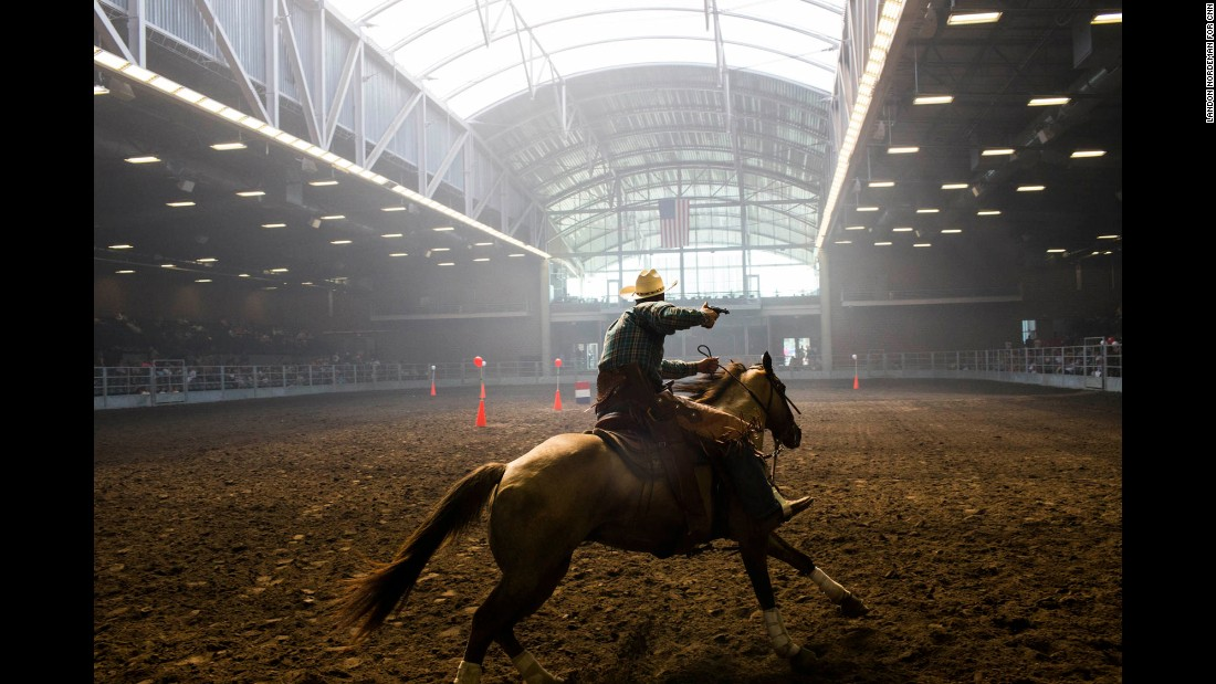 Brian Bolton, a Republican from Creston, Iowa, participates in a Cowboy Mounted Shooting competition.