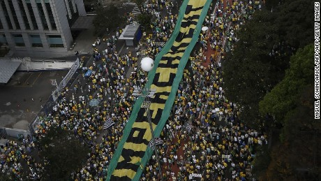 Demonstrators protest against Brazilian President Dilma Rousseff and the ruling Workers Party (PT), at Paulista Avenue in Sao Paulo,  Brazil on August 16, 2015. Protesters took to the streets of Brazil Sunday, kicking off nationwide rallies expected to draw hundreds of thousands demonstrating against corruption and economic slowdown, and calling for President Dilma Rousseff to step down. AFP PHOTO / Miguel SCHINCARIOL        (Photo credit should read Miguel Schincariol/AFP/Getty Images)