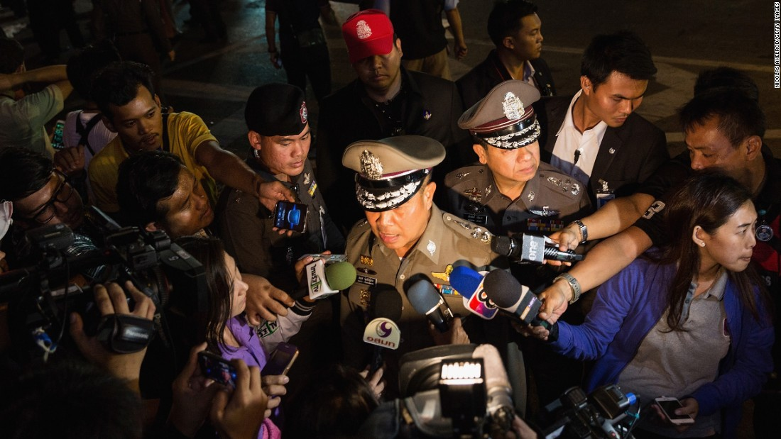 A police officer addresses the media after the explosion.