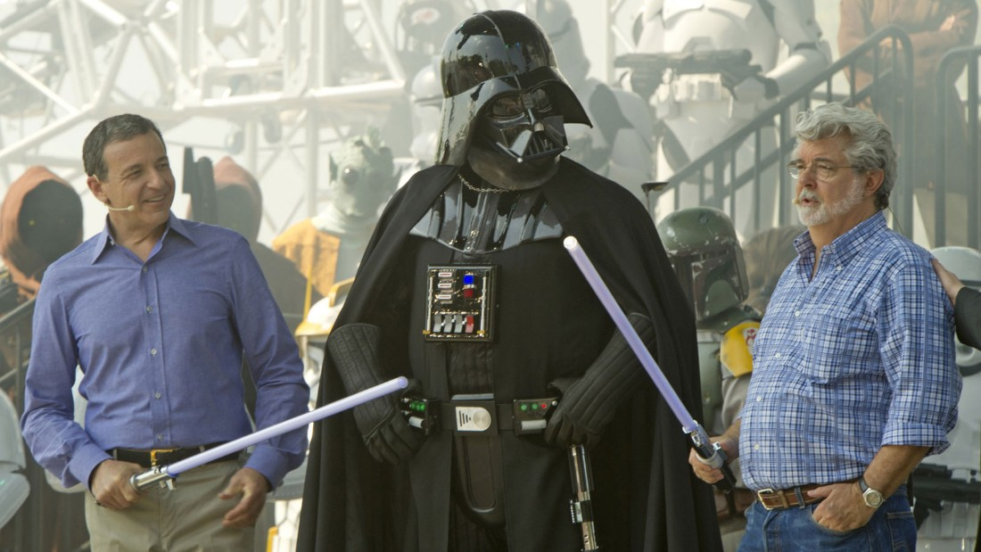 "Iger (left) and George Lucas (right) pose with Darth Vader at the opening of the ""Star Tours -- The Adventures Continue"" attraction at Disney's Hollywood Studios in 2011.  It's now been nearly three years since Disney bought Lucasfilm for $4 billion."