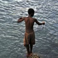 young boy fishing comoros islands