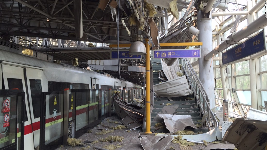 The Donghai Road light rail terminal station in Tianjin, China, is seen covered in debris on Monday, August 17.  Explosions at a chemical warehouse left more than a hundred people dead and hundreds injured. Fire officials say hazardous chemicals stored at the warehouse were ignited by fire, but the fire's cause is still being investigated.