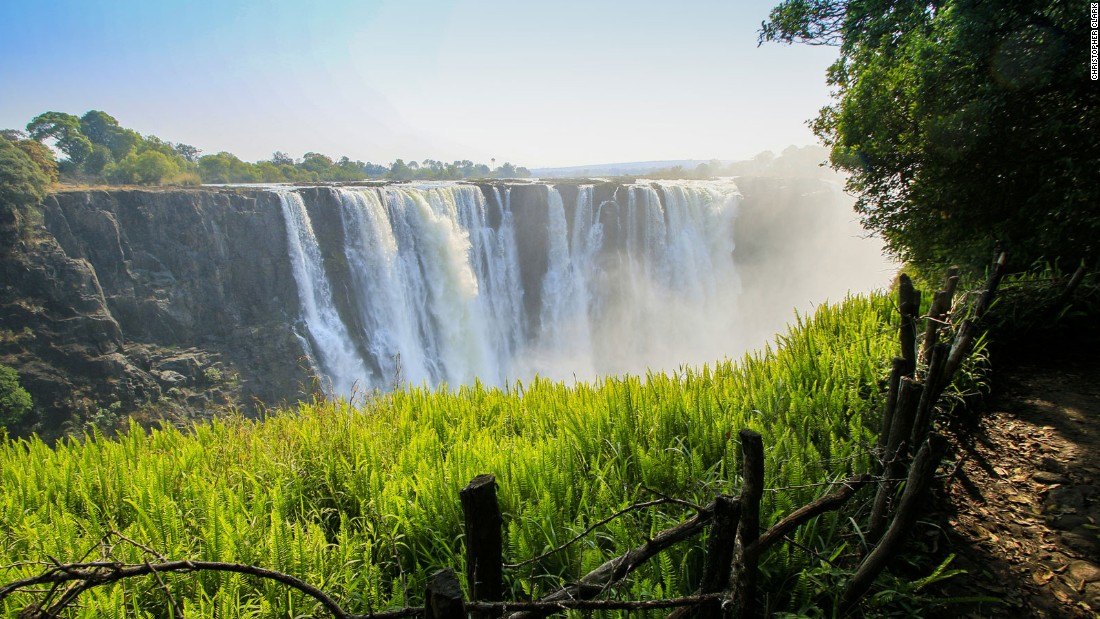"Known to locals as ""Mosi-oa-Tunya"" (""The Smoke that Thunders"") the spray from Victoria Falls can be seen rising high above the deep Batoka Gorge from kilometers away."