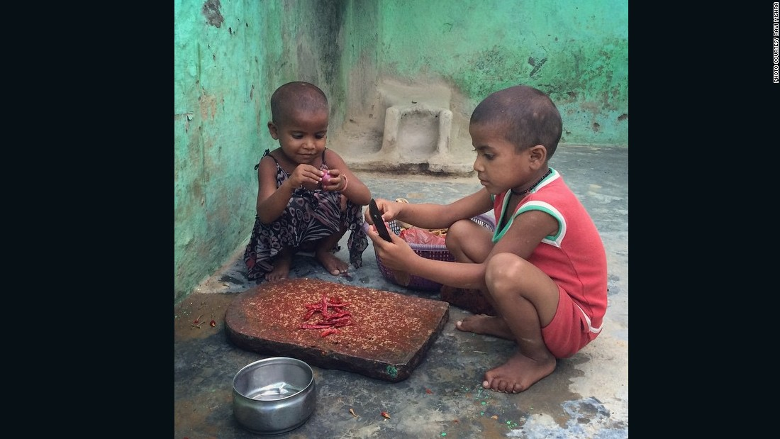 "Young siblings try to make <a href=""https://instagram.com/p/4a04rIn5wg/"" target=""_blank"">chutney</a> for lunch at their home in Meerut, India."