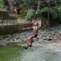 Mumbai child jumping in flood water Insta