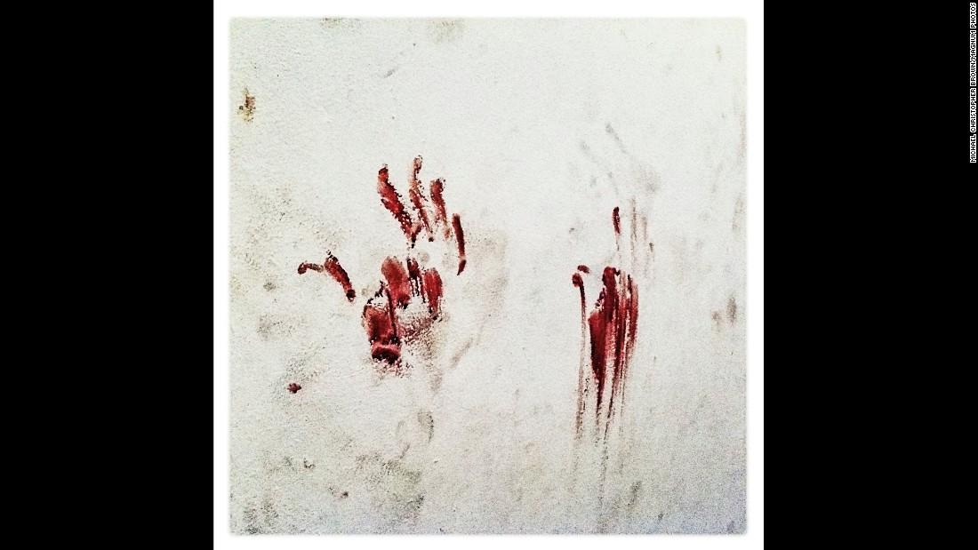Bloody handprints stain a former secret police cell inside an elementary school in Tripoli, Libya, in August 2011.