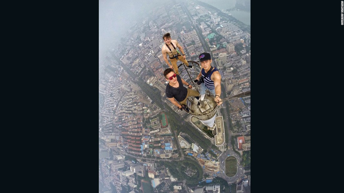 """Daniel Lau recently lit up <a href=""""http://www.yangtse.com/nanjing/2015-07-29/594410.html"""" target=""""_blank"""">Chinese media</a> by taking a selfie from above the fourth tallest building in China, the 450-meter Zifeng Tower in Nanjing, alongside notorious rooftoppers from Russia Vladimir Sidorov and Ivan Kuznetsov."""