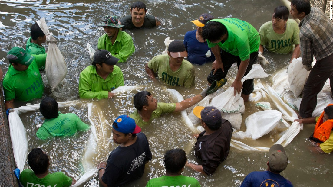 Workers build a dam from sandbags on August 19 as they attempt to seal off a canal to search for remnants of an explosive device that was thrown into the canal in Bangkok on Tuesday. Police spokesman Lt. Gen. Prawut Thavornsiri said Tuesday's blast at the Sathorn Pier was caused by a pipe bomb and could be related to the deadly explosion at a popular shrine in central Bangkok on Monday.