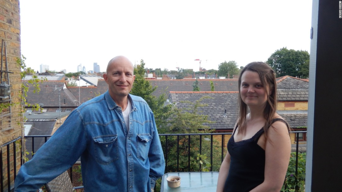 Peter Keserue and Karen Grace on the commune balcony. There is a maximum income for new housemates and diversity criteria. Places are always in demand due to the difficulty to make London's high rents for many.