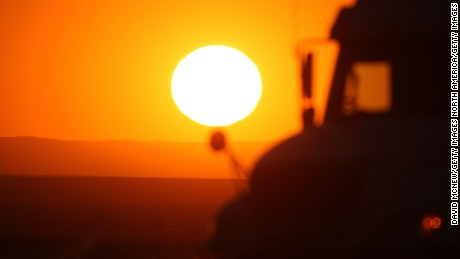 BUTTONWILLOW, CA - APRIL 16:  A truck passes before the setting sun on April 16, 2009 north of Buttonwillow, California. Central Valley farmers and farm workers are suffering through the third year of the worsening California drought with extreme water shortages and job losses. The office of California Governor Arnold Schwarzenegger predicts Central Valley farm losses of $325 million to $477 million and total losses for crop production and related business to be between $440 and $644 million. 16,200 to 23,700 full-time jobs are expected to be lost and food prices to rise nationwide.  (Photo by David McNew/Getty Images)