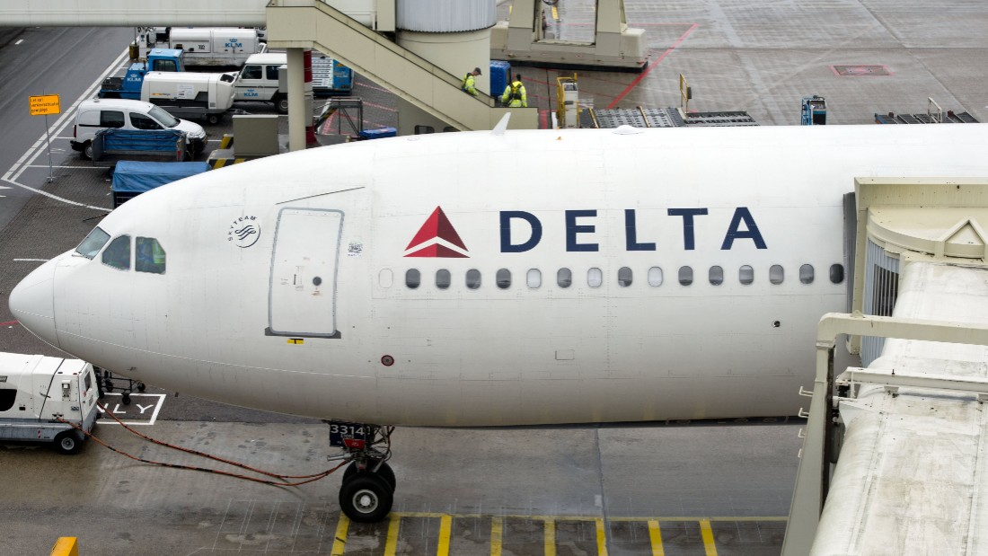 """A plane of Delta Airlines with 398 people on board, on his way from Paris to Detroit, made a precautionary landing at Schiphol airport on August 7, 2013. An Airbus headed from Paris to the US with over 300 people on board landed safely at Amsterdam Schiphol airport on Wednesday after it was diverted because its flaps jammed. """"The plane has landed safely at Schiphol,"""" air traffic control spokeswoman Bertine Langelaan told AFP. Delta Airlines said earlier that its Flight 99 to Detroit had been diverted because it was unable to retract its flaps after taking off from Paris hub Charles de Gaulle. AFP PHOTO  / ANP - MARCEL ANTONISSE = netherlands out        (Photo credit should read MARCEL ANTONISSE/AFP/Getty Images)"""