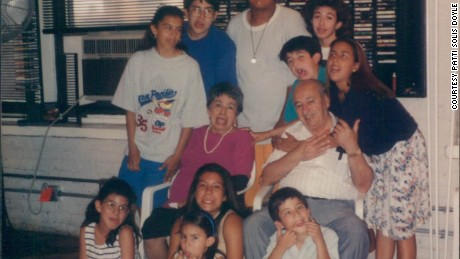 Doyle's parents, circa 1996, with some of their grandchildren.