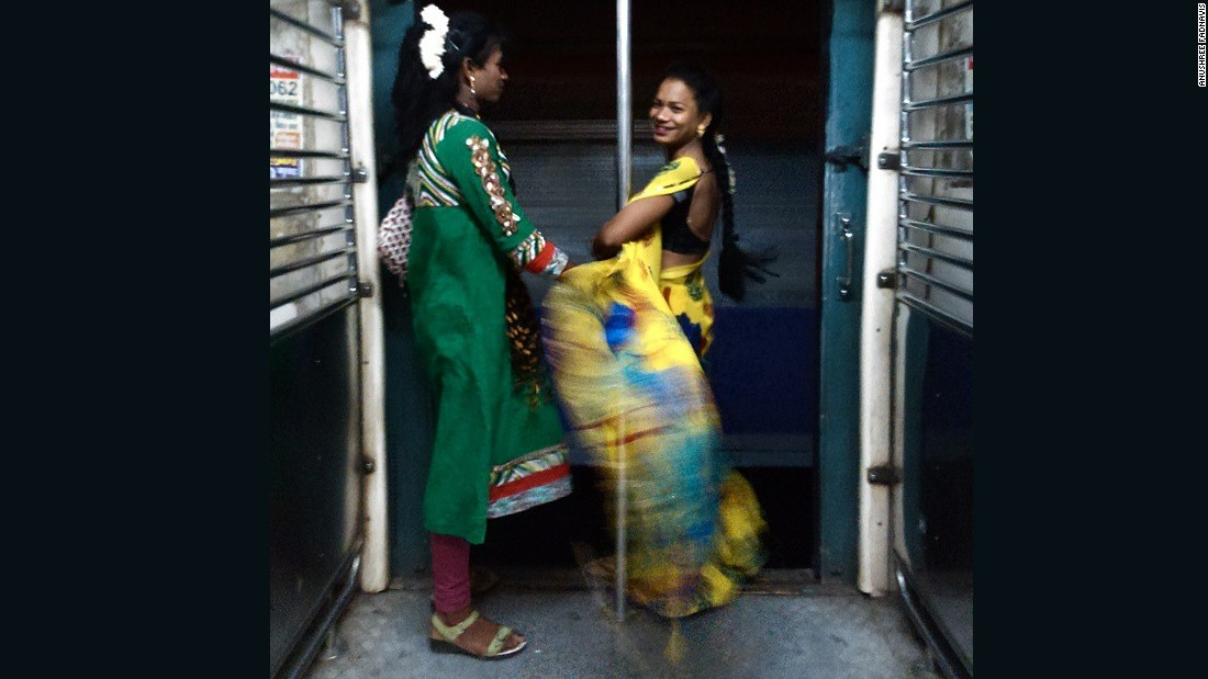 """<a href=""https://instagram.com/p/veY3QNOQw1/"" target=""_blank"">Barsha (left) and Sanjana</a> are eunuchs (men who have been castrated), dressed up for their everyday job. To me both looked so beautiful. Sanjana was smiling throughout. I asked Sanjana her age and she claimed to be 18 years old, which I don't think is true. Eunuchs in Mumbai usually travel in the train asking for money to run their daily life. They call it their job. Few of them work for late night events or as bar dancers."""