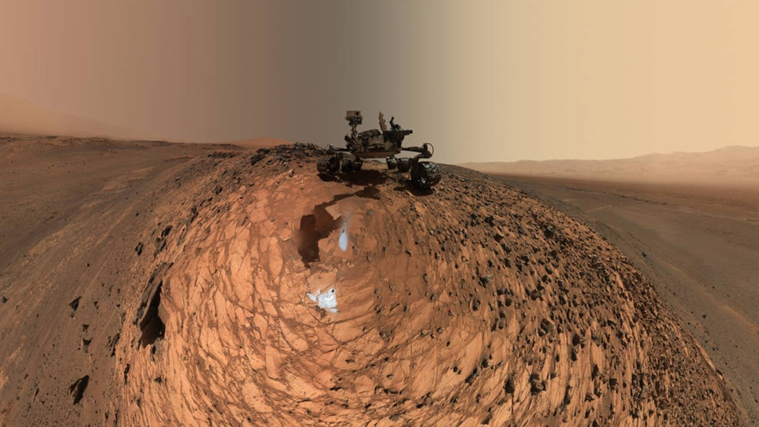 "NASA's Curiosity Mars rover snapped this new selfie which is actually a series of selfies combined. The images show the spacecraft above the ""Buckskin"" rock target where it drilled and collected its seventh sample of the martian soil. Dozens of images taken by Curiosity's Mars Hand Lens Imager on August 5, were combined to create the photo."