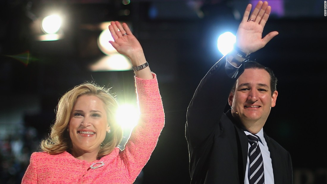 Cruz and his wife wave to the crowd at Liberty University after he announced his presidential candidacy in Lynchburg, Virginia, on March 23, 2015.