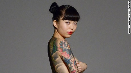 Good girls, not gangsters? Tattoos no longer taboo in China