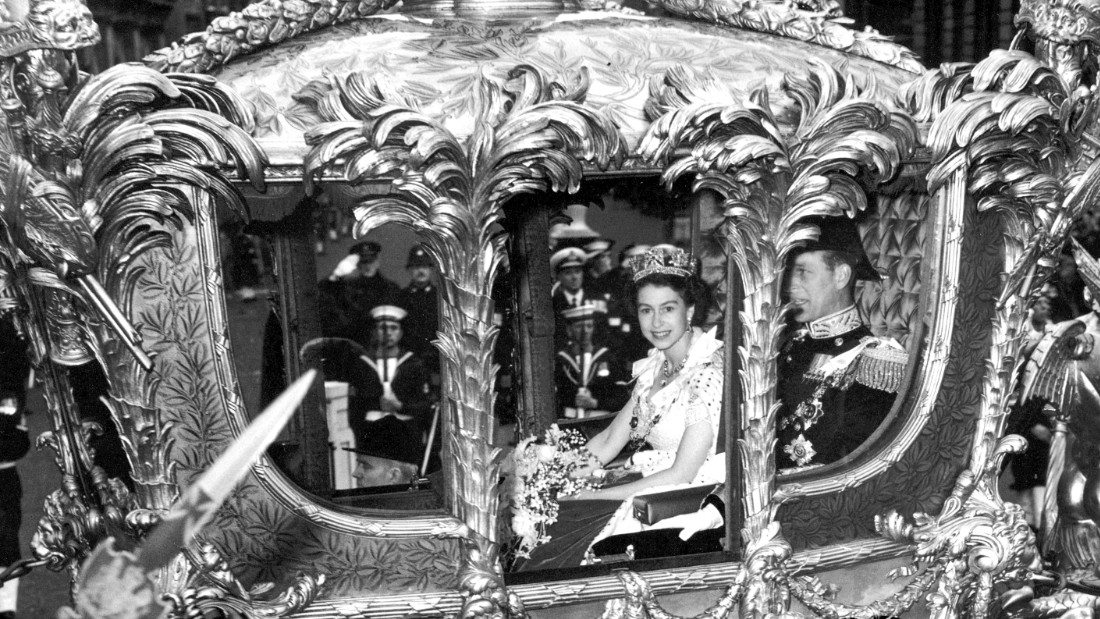 Queen Elizabeth II with Prince Philip, Duke of Edinburgh, in the Coronation Coach en route to Westminster Abbey for Elizabeth's coronation ceremony, June 2,1953.