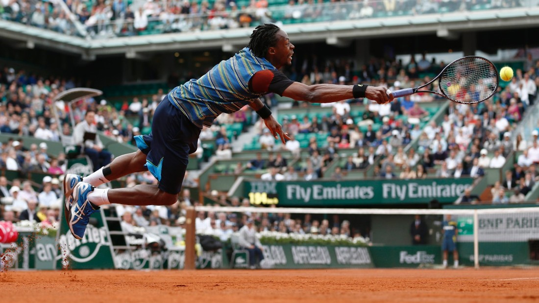 France's Gael Monfils dives in a try to return to Czech Republic's Tomas Berdych during their French Tennis Open first round match at the Roland Garros stadium in Paris, on May 27,  2013.  AFP PHOTO / THOMAS COEX        (Photo credit should read THOMAS COEX/AFP/Getty Images)