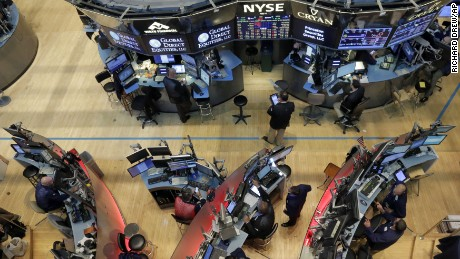 Traders work on the floor of the New York Stock Exchange, Friday, Aug. 21, 2015. U.S. stocks are sharply lower in midday trading on concerns about the Chinese economy. (AP Photo/Richard Drew)