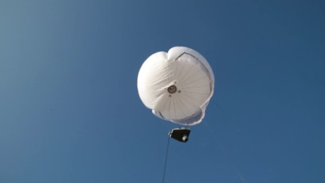 cnnee pkg guler hot air balloon to fight crime_00001229