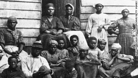 Portrait of Civil War 'contrabands,' fugitive slaves who were emancipated upon reaching the North, sitting outside a house, possible in Freedman's Village in Arlington, Virginia, mid 1860s. Up to 1100 former slaves at a time were housed in the government established Freedman's Village in the thirty years in which it served as a temporary shelter for runaway and liberated slaves. (Photo by Hulton Archive/Getty Images)